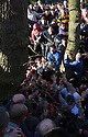 "17/02/15  <br /> <br /> Play moves into the river at the annual Royal Shrovetide Football  Match in Ashbourne, Derbyshire. After 'turning up' the ball at 2pm thousands of rival Up'Ards' and Down'Ards' team members attempt to 'goal' the ball onto stones set three miles apart in the town of Ashbourne, Derbyshire. The game also known as ""hugball"" has been played from at least c.1667 although the exact origins of the game are unknown but one of the most popular origin theories suggests the macabre notion that the 'ball' was originally a severed head tossed into the waiting crowd following an execution.<br /> <br /> <br /> All Rights Reserved - F Stop Press.  www.fstoppress.com. Tel: +44 (0)1335 418629 +44(0)7765 242650"