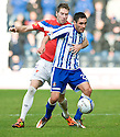 RANGERS' KIRK BROADFOOT GETS A GRIP 0F KILMARNOCK'S DANNY RACCHI