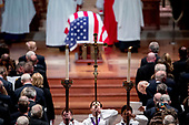 The flag-draped casket of former President George H.W. Bush is visible as altar servers line up in the center isle during Bush's State Funeral at the National Cathedral, Wednesday, Dec. 5, 2018, in Washington. <br /> Credit: Andrew Harnik / Pool via CNP