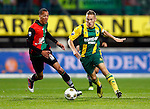 Nederland, Nijmegen, 5 oktober 2012.Eredivisie.Seizoen 2012-2013.N.E.C.-ADO Den Haag.Jens Toornstra (r.) van ADO Den Haag en Ryan Koolwijk (l.) van N.E.C. strijden om de bal.