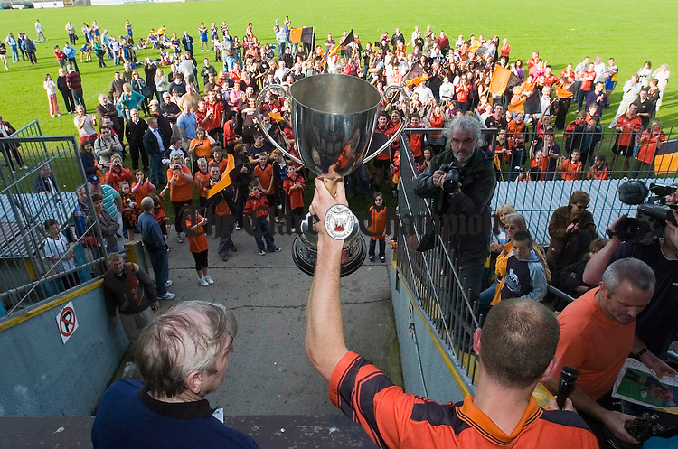 Ballyvaughan/Fanore captain Mark O Loughlin shows the cup to an appreciative crowd after the Intermediate county Football final in Cusack Park. Phoograph by John Kelly.