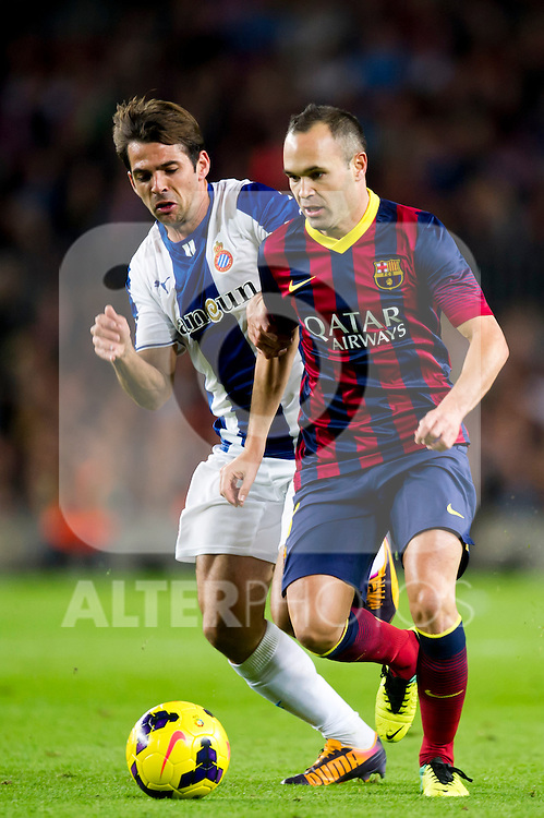 RCD Espanyol's Victor Sanchez (left) and FC Barcelona's Andres Iniesta (right) fight for the ball during La Liga 2013-2014 match. November 1, 2013. (ALTERPHOTOS/Alex Caparros)