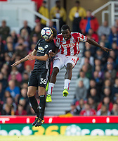 Mame Biram Diouf of Stoke City & Matteo Darmian of Man Utd during the Premier League match between Stoke City and Manchester United at the Britannia Stadium, Stoke-on-Trent, England on 9 September 2017. Photo by Andy Rowland.
