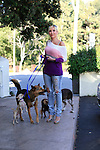 Ariane Bellamar walks her four dogs