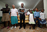 Worshippers in an evangelical church in La Hoya, a small rural town near Barahona in the southwest of the Dominican Republic. The service brings together Dominicans and Haitian-Dominicans from a nearby batey in an unusual demonstration of unity in a land where discrimination against Dominicans of Haitian ancestry is growing.