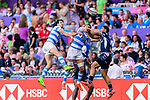 Martin Iosefo of USA (R) jumps for gets the ball during the HSBC Hong Kong Sevens 2018 match for Plate Final between Argentina and USA on 08 April 2018, in Hong Kong, Hong Kong. Photo by Marcio Rodrigo Machado / Power Sport Images