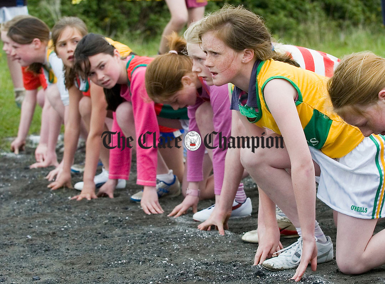 Competitors await the starters whistle at the Clare Track and Field championships at Mullagh. Photograph by John Kelly.