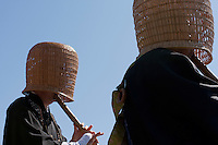 Komuso monks playing the shakuhachi with a basket over their head to show their detatchment from the world in Ueno park, Tokyo, Japan April 2nd 2009