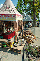 Rocks containing gemstone on the footpath, the finished products on display (and for sale) in the little tent/shop