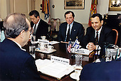 United States Secretary of Defense William Perry (left, back to camera) meets with an Israeli delegation led by Foreign Minister Ehud Barak (right) at the Pentagon on January 22, 1996.  Accompanying Minister Barak are Israeli Ambassador to the U.S. Itimar Rabinovich (center) and Mr. Etan Bentsur, special assistant to the foreign minister (left).<br /> Mandatory Credit: Robert D. Ward / DoD via CNP