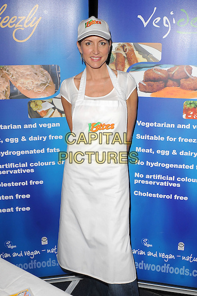 HEATHER MILLS.Heather Mills demonstrates how to to cook fresh vegan meals at the Brighton Eco Veggie Fayre, Hove Town Hall, Hove, England..20th March 2010.half length kitchen cook cooking food hat white apron 3/4.CAP/BEL.©Tom Belcher/Capital Pictures.