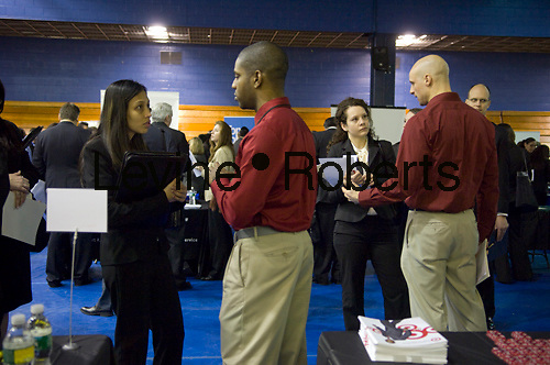 Job seekers attend a job fair sponsored by MyWorkster for graduate business students and alumni from 24 schools at Pace University in New York on Friday, January 22, 2010.  The government announced unemployment rates increased in 43 states the month of December 2009.  (© Frances M. Roberts)