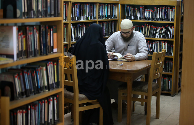 Palestinian researchers read books at Nablus public library in the West Bank city of Nablus, on August 6, 2017. Nablus public library, the largest, and the oldest, in all of Palestine, opened in 1960, and library includes approximately 80,000 books, the majority of which are in Arabic. Besides the circulating collection, Nablus Library also houses several significant archival collections, including the so-called Prisoner's Section, an archive of materials made and used by Palestinian prisoners held in Israeli jails between 1975 and 1995, as well as the personal collection of Qadri Tuqan, a Nablusi educator and one of the founders of An-Najah College, now An-Najah National University.Other collections include Palestinian newspapers dating back to the 1920s. Photo by Ayman Ameen