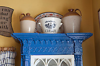 A vintage cream bowl is diplayed on top of a blue-painted Irish vernacular cabinet in the kitchen