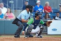 Gwinnett Stripers catcher John Ryan Murphy (12) sets a target as home plate umpire Charlie Ramos looks on during the game against the Scranton/Wilkes-Barre RailRiders at BB&T BallPark on August 16, 2019 in Lawrenceville, Georgia. The Stripers defeated the RailRiders 5-2. (Brian Westerholt/Four Seam Images)
