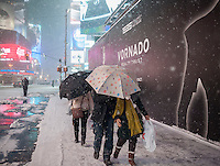 "Visitors to Times Square in New York during a snow storm on Tuesday evening, January 21, 2014. The official snowfall in Central Park was 11 inches (28 centimeters) which was a record for the day.  Brutal ""Polar Express"" temperatures in the single digits accompanied the snow with the arctic temperatures expected to last several days.  (© Richard B. Levine)"