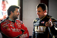 Oct. 30, 2009; Talladega, AL, USA; NASCAR Sprint Cup Series driver Tony Stewart (left) talks with teammate Ryan Newman during practice for the Amp Energy 500 at the Talladega Superspeedway. Mandatory Credit: Mark J. Rebilas-