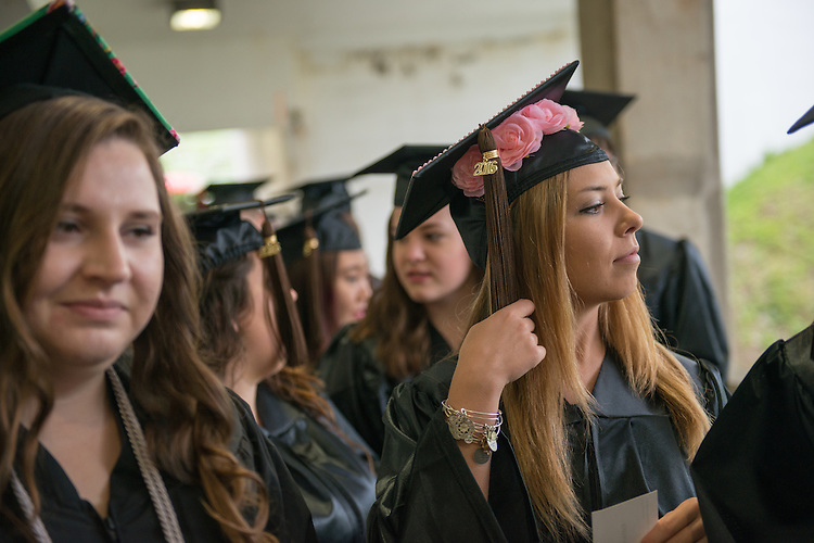 Katherine Tlapa (Right) at undergraduate commencement. Photo by Ben Siegel