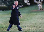United States President Donald J. Trump gestures after disembarking Marine One walking on the South Lawn towards the Oval Office of the White House in Washington, DC, USA, 05 March 2017. Trump returned to Washington from a weekend at his Palm Beach. Florida, Mar-a-Lago club.<br /> Credit: Erik S. Lesser / Pool via CNP