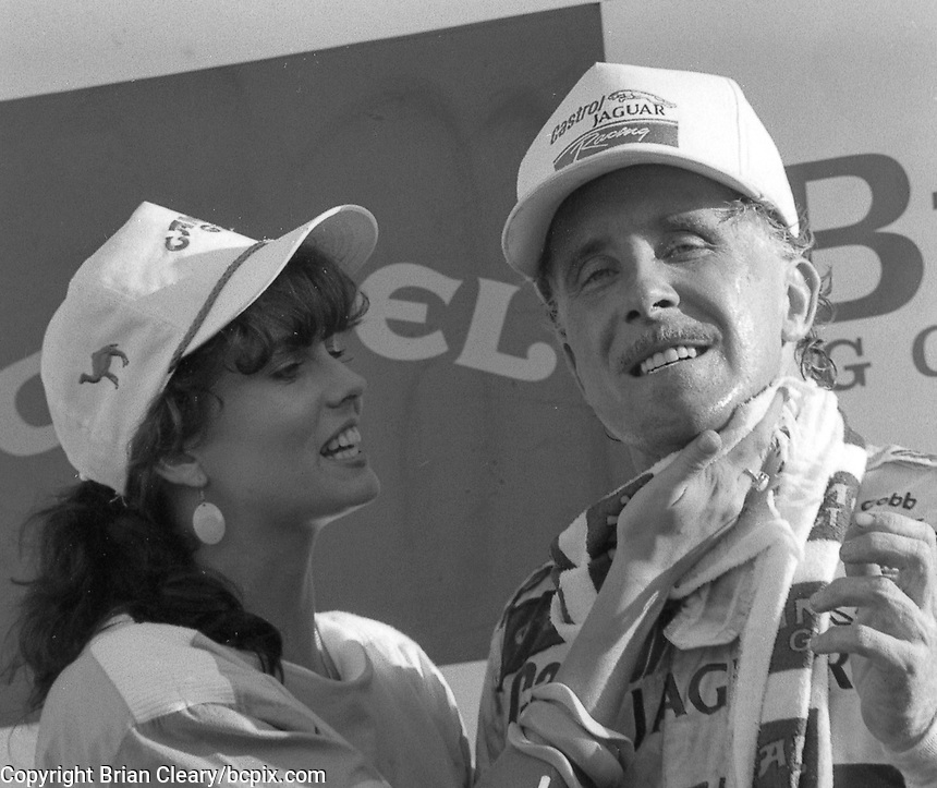 Price Cobb gets a kiss from Miss Camel GT after driving his Castrol Racing Jaguar XJR-10 to victory in the IMSA GTP/Lights race at the Florida State Fairgrounds in Tampa, FL, October 1, 1989. (Photo by Brian Cleary/www.bcpix.com)