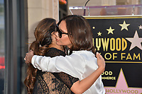 Eva Longoria &amp; Victoria Beckham at the Hollywood Walk of Fame Star Ceremony honoring actress Eva Longoria, Los Angeles, USA 16 April 2018<br /> Picture: Paul Smith/Featureflash/SilverHub 0208 004 5359 sales@silverhubmedia.com