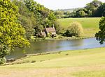 Lakeside cottage lake at Bowood House and gardens, Calne, Wiltshire, England, UK