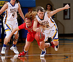 BROOKING, SD - NOVEMBER 13:  Macy Miller #12 from South Dakota State battles for the ball with Claire Oberdorf #1 form Marist in the second half of their game Friday night at Frost Arena in Brookings. (Photo by Dave Eggen/Inertia)