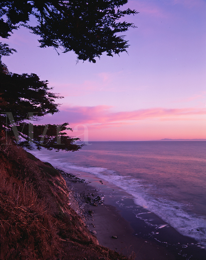 Scenic pastel sunset seascape of the Arroyo Burro Beach County Park as seen from the Douglas Family Preserve. Santa Barbara, California.