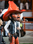 The Oklahoma State Cowboy's mascot, Pistol Pete, watches the action during the game between the Oklahoma State Cowboys and the University of Texas in Austin Texas Longhorns at the Daryl K. Royal- Texas Memorial Stadium in Austin, Texas. The Oklahoma State Cowboys defeated the Texas Longhorns 33 to 16.