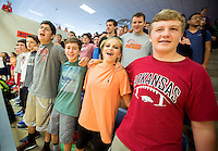 NWA Democrat-Gazette/JASON IVESTER <br /> Rogers Heritage freshmen Caleb Dickerson (from left), Austin Anderson, Alyssa Slone and Mason Barton sing the school's alma mater on Wednesday, Sept. 2, 2015, in the school's gym. Senior members of the Link Crew led a pep rally practice for freshmen.