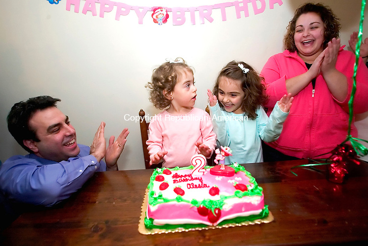 WATERTOWN, CT- 29 DEC 06- 123006JT32- <br /> Alesia Faith Pandiscia, center, is applauded by her father Stephen, sister Olivia, 5, and aunt Daniela DiCicco at the Pandiscia's Watertown home on Dec. 29, 2006.<br /> Josalee Thrift Republican-American
