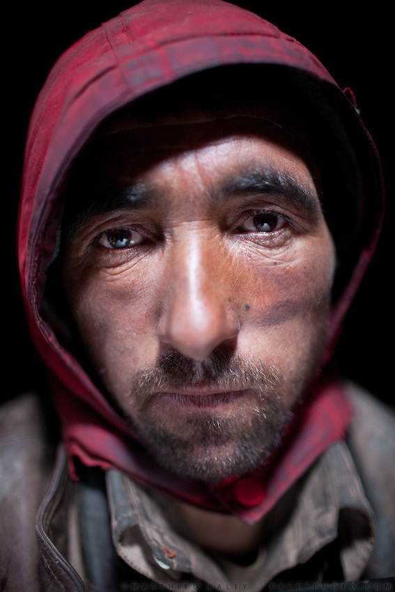 Noor Mohammed, shepherd, 25 yrs old, eat 2 breads called peutok + 4 cup chai in morning and then head out in the field all day..In Zardibar. .Trekking back down from the Little Pamir, with yak caravan, over the frozen Wakhan river.