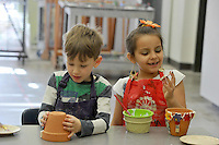 NWA Democrat-Gazette/MICHAEL WOODS • @NWAMICHAELW<br /> Loukas Gowthrop, 6, and Gabriella Zelaya, 6, work on creating mosaic flower pots Wednesday, March 23, 2016, during  the Spring Break Camp at the Community Creative Center in Fayetteville.  The spring break camp gave kids a chance to create colorful art  inspired by the joyfulness of Spring with activities including watercolor painting, drawing with soft pastels, mosaic sculptures, and mosaic flower pots for the garden.