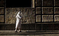 A nun walks the streets in Naples, Italy in 2009...PHOTOS/ MATT NAGER