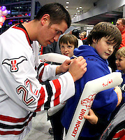 UNO's Tony Turgeon signs autographs after the game. UNO beat St. Cloud State 3-0 Friday night at Qwest Center Omaha.  (Photo by Michelle Bishop)