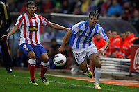 5.05.2012 SPAIN -  La Liga matchday 37th  match played between Atletico de Madrid vs Malaga (2-1) at Vicente Calderon stadium. The picture show Eduardo Salvio (Argentine midfielder of At. Madrid) and Nacho Monreal Eraso (Spanish defender of Malaga)