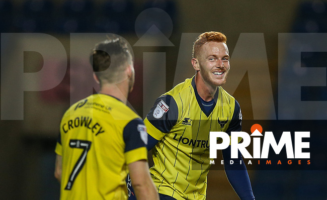 Ryan Taylor of Oxford United smiles at Dan Crowley of Oxford United after he narrowly missed goal with an overhead kick during the The Checkatrade Trophy match between Oxford United and Exeter City at the Kassam Stadium, Oxford, England on 30 August 2016. Photo by Andy Rowland / PRiME Media Images.