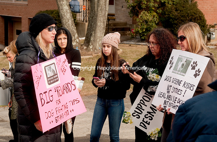 WATERBURY, CT--- -013116JS01--Protesters including Michelle Terninko of New York City, left, stand outside a home on Gail Drive in Waterbury on Sunday. The people were concerned about the possibility the home owner was fighting dogs. <br /> Jim Shannon Republican-American