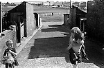 South Kirkby Colliery Yorkshire England. 1979.  Children playing in back alley.<br />