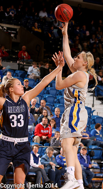 BROOKINGS, SD - OCTOBER 30:  Mariah Clarin #40 from South Dakota State University looks for the short hook shot over xxxxxxx #33 from South Dakota School of Mines in the second half of their exhibition game Thursday night at Frost Arena in Brookings. (Photo by Dave Eggen/Inertia)