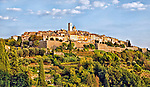Saint Paul de Vence, viewed from the Route de la Colle in the reddish light of a late afternoon sun.