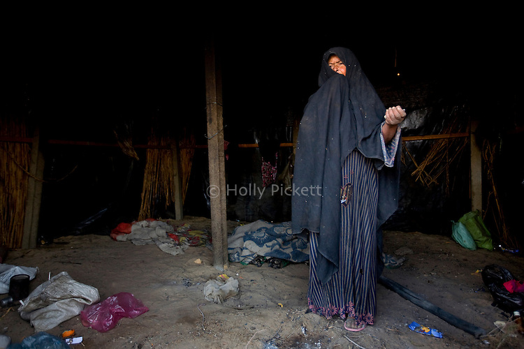 An indigent Bedouin woman in her home in the Sinai peninsula, Jan. 29, 2010. Some Bedouin make a living smuggling goods and humans from Egypt across the Gaza and Israel borders. A barrier wall being built buy Egypt may impact the illegal trade, causing strife between the government and Egypt's marginalized Bedouin tribes.