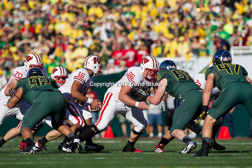 Wisconsin Badgers offensive lineman/center Peter Konz (66) blocks Oregon Ducks defensive lineman Taylor Hart (66) during the 2012 Rose Bowl NCAA football game in Pasadena, California on January 2, 2012. The Ducks won 45-38. (Photo by David Stluka)
