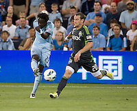 Kei Kamara, Zach Scott. Sporting Kansas City won the Lamar Hunt U.S. Open Cup on penalty kicks after tying the Seattle Sounders in overtime at Livestrong Sporting Park in Kansas City, Kansas.