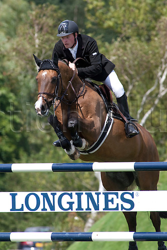 HICKSTEAD ENGLAND. 31-07-2010. Lance Whitehouse (GBR) riding Transmission, competing in The Old Lodge Queen Elizabeth II Cup, during The Longines Royal International Horse Show, held at The All England Jumping Course, Hickstead.