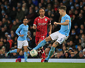 9th January 2018, Etihad Stadium, Manchester, England; Carabao Cup football, semi-final, 1st leg, Manchester City versus Bristol City; John Stones of Manchester City clears the ball from Bobby Reid of Bristol City
