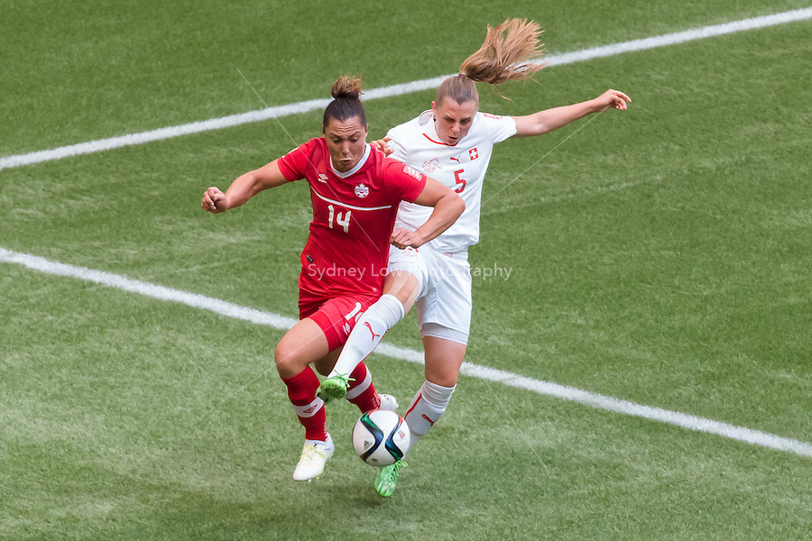 June 21, 2015: Melissa TANCREDI of Canada and Noelle MARITZ of Switzerland fight for the ball during a round of 16 match between Canada and Switzerland at the FIFA Women's World Cup Canada 2015 at BC Place Stadium on 21 June 2015 in Vancouver, Canada. Canada won 1-0. Sydney Low/Asteriskimages.com