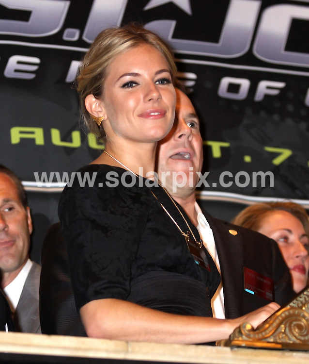 "**ALL ROUND PICTURES FROM SOLARPIX.COM**.**SYNDICATION RIGHTS FOR UK, AUSTRALIA, DENMARK, PORTUGAL, S. AFRICA, SPAIN & DUBAI (U.A.E) ONLY**.Sienna Miller and the Cast of ""G.I. Joe: The Rise of Cobra"" Ring the Opening Bell at the New York Stock Exchange, New York City, USA. 4 August 2009..This pic: Sienna Miller..JOB REF: 9694 PHZ (Mayer)   DATE: 04_08_2009.**MUST CREDIT SOLARPIX.COM OR DOUBLE FEE WILL BE CHARGED**.**MUST NOTIFY SOLARPIX OF ONLINE USAGE**.**CALL US ON: +34 952 811 768 or LOW RATE FROM UK 0844 617 7637**"