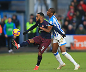 9th February 2019, The John Smith's Stadium, Huddersfield, England; EPL Premier League football, Huddersfield versus Arsenal; Alexandre Lacazette of Arsenal controls the ball under pressure from Terence Kongolo of Huddersfield Town