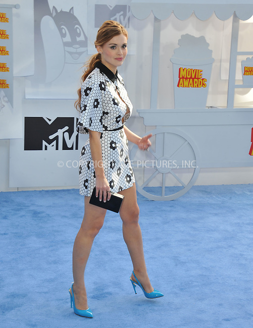 WWW.ACEPIXS.COM<br /> <br /> April 12 2015, LA<br /> <br /> Holland Roden arriving at the 2015 MTV Movie Awards at the Nokia Theatre L.A. Live on April 12, 2015 in Los Angeles, California.<br /> <br /> By Line: Peter West/ACE Pictures<br /> <br /> <br /> ACE Pictures, Inc.<br /> tel: 646 769 0430<br /> Email: info@acepixs.com<br /> www.acepixs.com